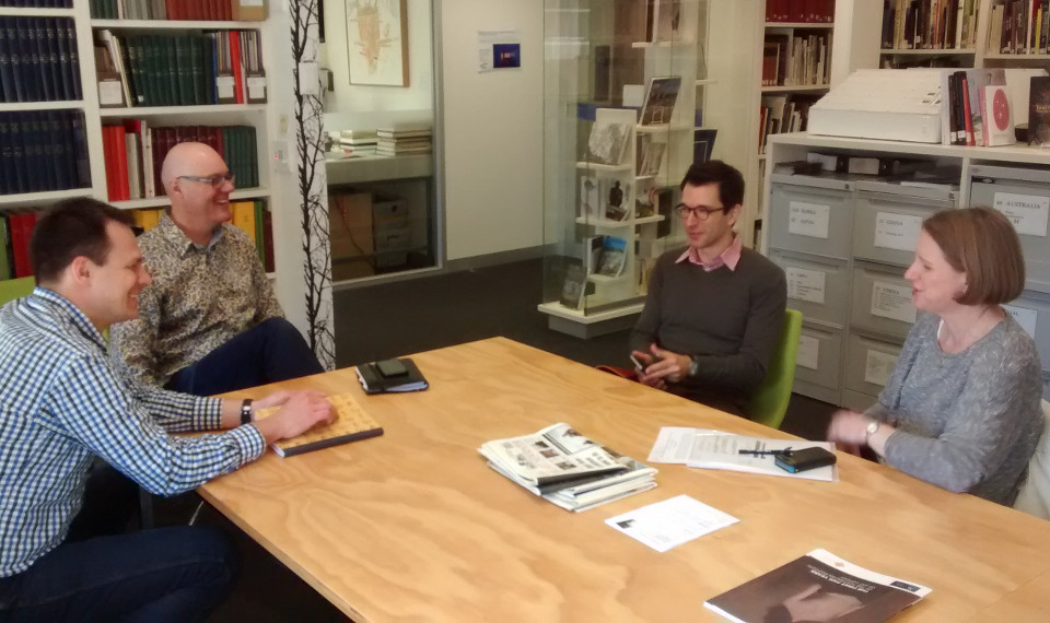 Martin Tomko, Mark Stevenson and Jodie Mcvernon speaking with Iyad in the Visual Cultures Resource Centre